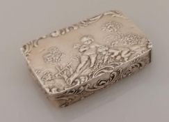 A 19th century oblong 800 silver pill or snuff box of oblong form with embossed cupids in a