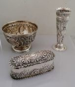A Victorian silver oblong box with hinged cover with elaborate embossed rococo decoration by Charles