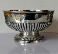 An Edwardian silver rose bowl with half-fluted decoration on a raised foot by Mappin & Webb,