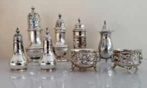 A pair of Victorian silver salts with oak leaf and acorn decoration on scroll feet by Mappin & Webb,