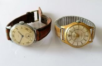 A 1950s Smiths wrist watch with two-tone dial, 29mm, Roman numerals, subsidiary seconds hand,