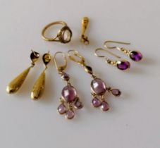 Two pairs of gold and amethyst earrings, another pair (one back missing) and a half and a gold ring,