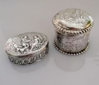 Two Continental 19th century silver boxes with allegorical scenes in relief to lids and sides,