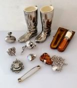 An assortment of silver bibelots to include a scent bottle, moonstone ring, articulated silver scull