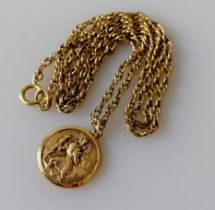 A gold St. Christopher pendant and chain, hallmarked 9ct, 18mm diameter, chain 52 cm, 9.06g
