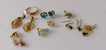 Five and a half pairs of earrings, two more with matching pendants, most gem-set, all stamped/