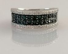 An 18ct white gold half-hoop eternity ring with pave-set white and black diamonds, size N1/2,