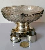 A George V silver tazza with a frosted glass liner, wavy rim, elaborate pierced decoration on a