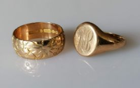 A yellow gold wedding band with etched decoration, 7mm and a signet ring, initialled, both size P1/