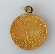 A German 10 mark Grand Duke Friedrich gold coin with chain loop, 4.16g