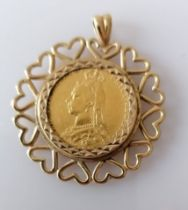 A Victorian gold full sovereign, 1888, Melbourne mint on a hallmarked 9ct gold mount, 12g
