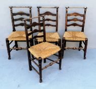 A harlequin set of four early 19th century ash and elm Macclesfield dining chairs with ladder backs,