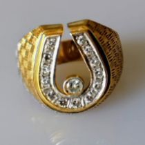 A mid-20th century gold and diamond ring with thirteen round-cut diamonds, each approximately 0.02