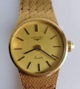 A 1980's ladies 9ct gold Longines quartz wristwatch, the circular gold tone dial signed 'Longines