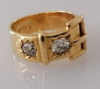 A Victorian 18ct gold buckle ring with two old mine-cut diamonds, approximately 0.50 carats (