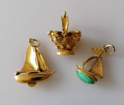 Three Italian gold charms or pendants, two gem-set, largest 33mm, two stamped 750, one tests for