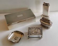 An Art Deco silver cigarette box with engine turned design, wood-lined interior, vacant cartouche by