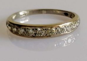 A white gold and diamond half-hoop eternity ring, size O, 2.63g