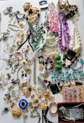 A large assortment of costume jewellery to include necklaces, brooches, rings, watches, etc.