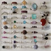An assortment of forty silver -based gem-set rings, mostly sizes N-P, three pairs of earring and a