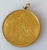 A mounted 1909 Austrian, Franz Joseph I 100 Corona gold coin, the mount stamped 585, 35.87g