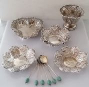 A pair of late Victorian silver pierced bon-bon dishes with profuse rococo vine decoration in relief