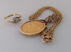 A Victorian gold full sovereign, 1872, on a hallmarked 9ct gold mount and chain, 13.9g and a 18ct