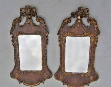 A near pair of Queen Anne period walnut and giltwood wall mirrors, Campana carved and scrolling
