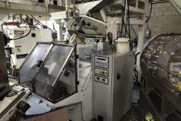 Martini Bagger, includes: in-feed and out-feed converyor scales, mezzanine, multiple formers, three