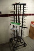 A JACK STACK Black Steel One Hundred and Four Plate capacity Castor mounted Plate Rack