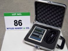 A LUTRON Hand Held Digital Stage Lighting Programmer with Shoulder Strap in a Dedicated Storage