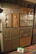 A Black Steel Framed Wall Mounted Fibreglass 3D Relief Panel Depicting Vintage Medical, Dental,
