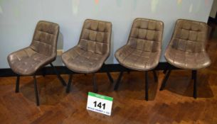 A Set of Four Grey Leather Upholstered Stitch Patterned Side Chairs on Black Painted Timber Legs