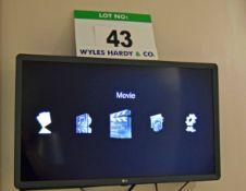 An LG Model 32LK 610BPLB 32 inch Smart Flat Screen Television on An Articulated Wall Bracket