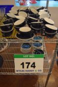 A Quantity of ACME Black and White Glazed China Coffee Cups comprising Forty Two Cups with Forty