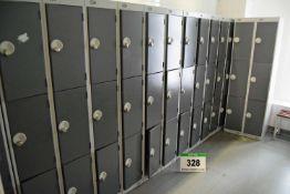 Four Grey Steel 9-Door Personnel Lockers, Two Grey Steel 6-Door Personnel Lockers and A Grey Steel