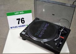 A TECHNICS SL1210 MK5 Quartz Direct Drive Turntable (As Found - has Cracked Perspex Lid and
