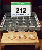 A Plastic Dishwasher Basket containing Twenty Five Cordial Glasses