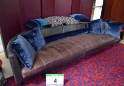 A Leather Upholstered Low Couch having Twin Section Bases with Single Tan Leather Upholstered