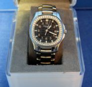 A PHILIPPE PATEK Ladies Aquanaut Model 5087 Watch in a 35mm dia. Case, with Black Dial surrounded by