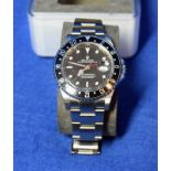 A ROLEX GMT-Master II Watch in a 40mm dia. Oyster Steel Case, with a Black Dial surrounded by a